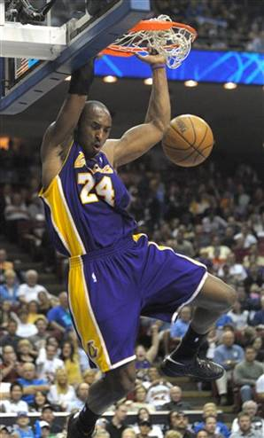Kobe Bryant Dunking Pictures. Kobe Bryant did a lot of