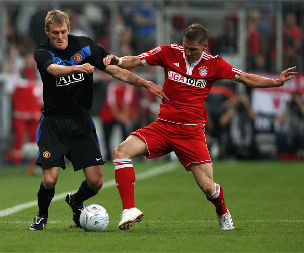 Bastian Schweinsteiger and Darren Fletcher