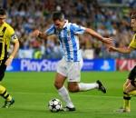 Málaga's Jeremy Toulalan runs with the ball