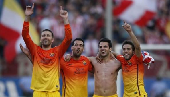 Gerard Pique, Sergio Busquets, Cesc Fabregas and Jordi Alba celebrating Barcelona's fourth league title in five years.