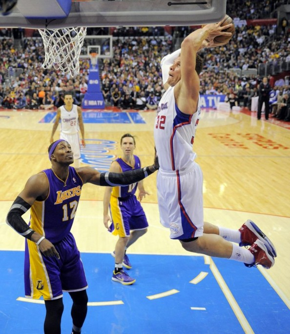 Blake Griffin dunking on Dwight Howard