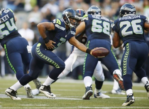 Russell Wilson e1376828232432 Seattle Seahawks   Russell Wilson Gets Help From Defense & Jermaine Kearse