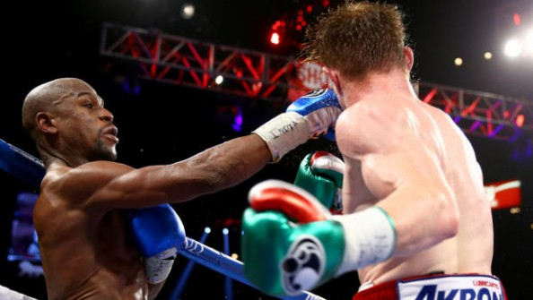 Mayweather Hitting Canelo e1379774017969 Most Watched PPV Fights in Boxing History