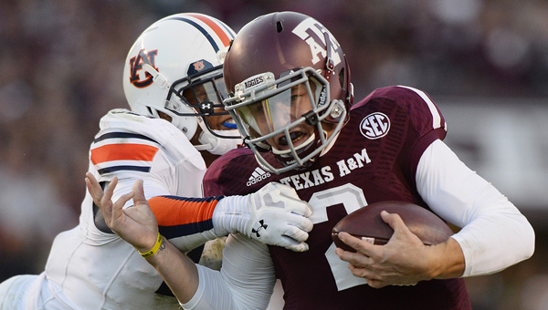 Johnny Manziel was sacked three times as #7 Texas A&M lost to #24 Auburn 45-41.
