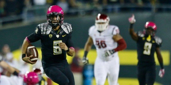 Marcus Mariota led #2 Oregon to a 62-38 win over Washington State, throwing 2 touchdown passes and running 57 yards for another score.