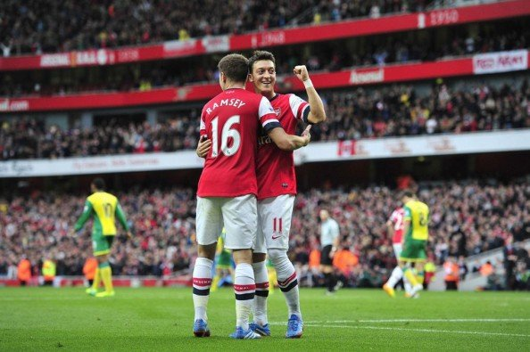 Mesut Ozil scored his first two goals in the Premier League for Arsenal as they won 4-1.