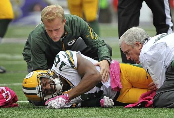 Randall Cobb had to be carted off the field after he was injured by Matt Elam of the Baltimore Ravens