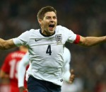 Steven Gerrard scored the second goal for England in their 2-0 win over Poland, helping them finish first in the group and automatically qualify to the World Cup
