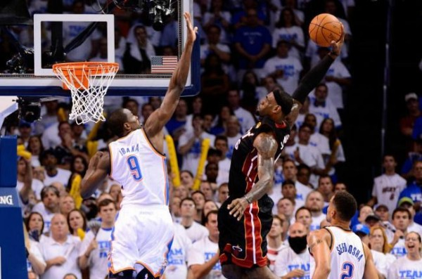 LeBron James dunking on Serge Ibaka