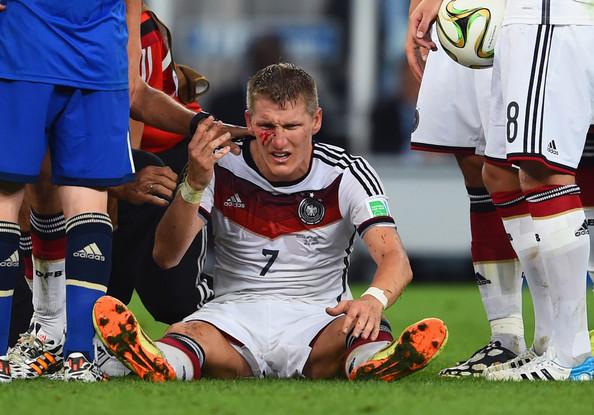 Bastian Schweinsteiger getting hit