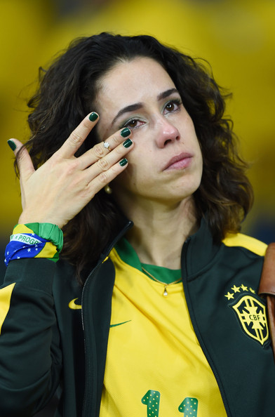 Brazil fan wiping her tears