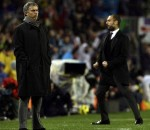 Barcelona's coach Guardiola greets Real Madrid's coach Mourinho react after Barcelona's second goal during their Spanish first division soccer match in Barcelona