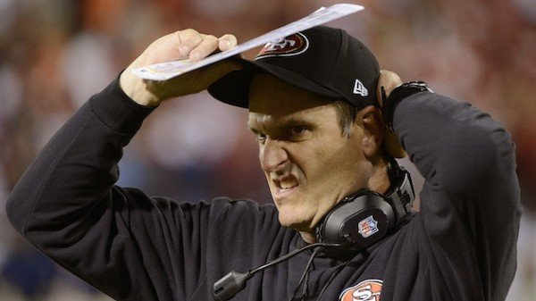 Hat adjusting Harbaugh