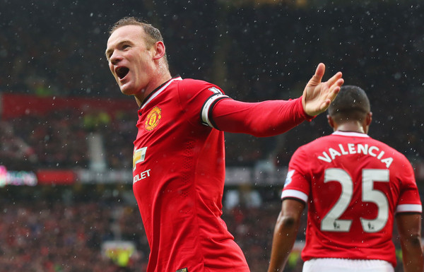 Wayne Rooney celebrating as Manchester United beat Manchester City in the derby 4-2
