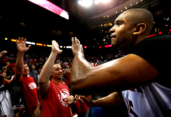 Al Horford celebrating with Hawks fans after hitting the game winning shot