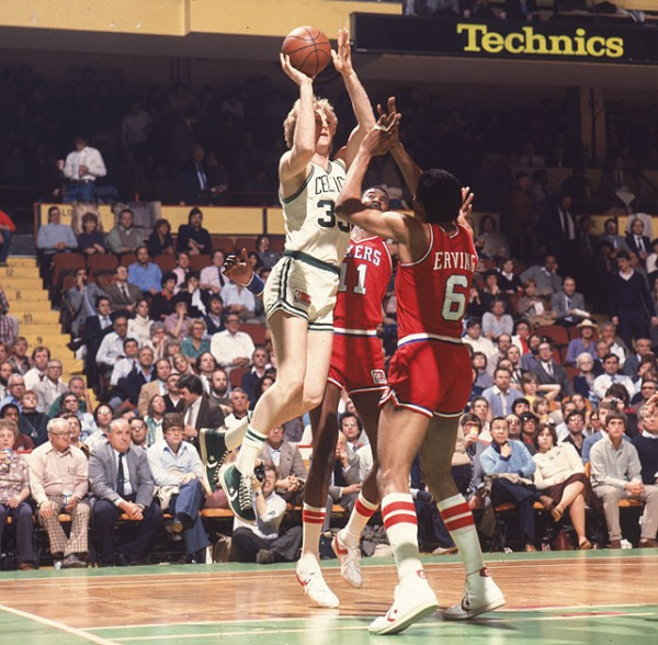 Larry Bird shooting over Julius Erving