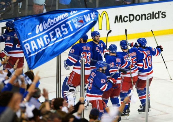 New York Rangers players celebrating after Derek Stepan's overtime goal