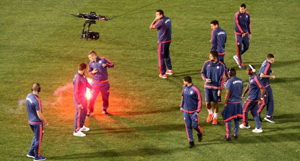 Olympiakos fans hit by flare