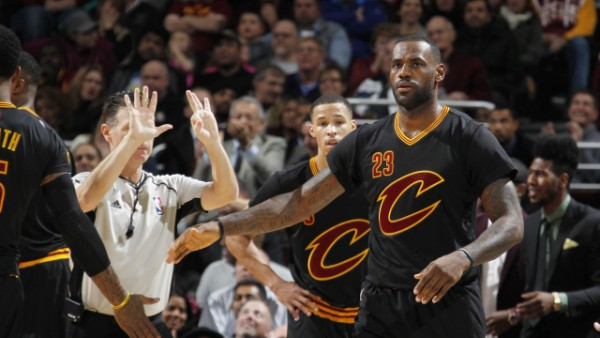LeBron leads Cavs past Magic, joins Robertson on elite list