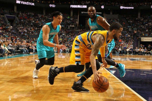 Charlotte Hornets defending D.J. Augustin