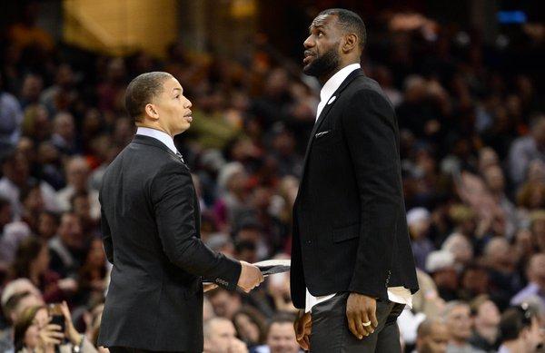 Coach LeBron James with Tyronn Lue