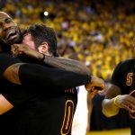 LeBron James hugging Kevin Love