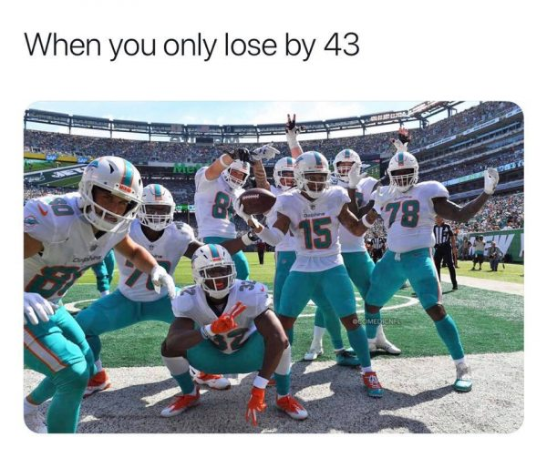 Dolphins Celebrating a 43-point loss